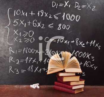 Royalty Free Photo of a Chalkboard and Textbooks