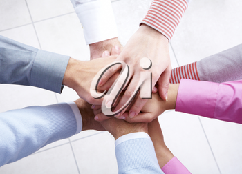 Close-up of business people's hands on top of each other