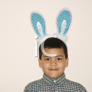 Royalty Free Photo of a Little Boy Wearing Bunny Ears