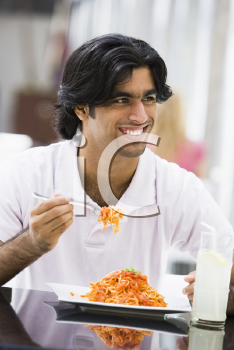 Royalty Free Photo of a Man Eating Spaghetti