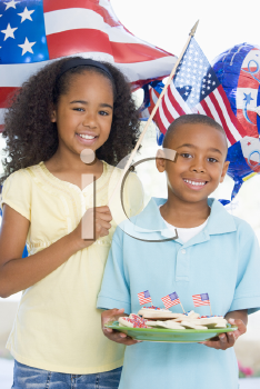 Royalty Free Photo of a Children With American Flags and Cookies