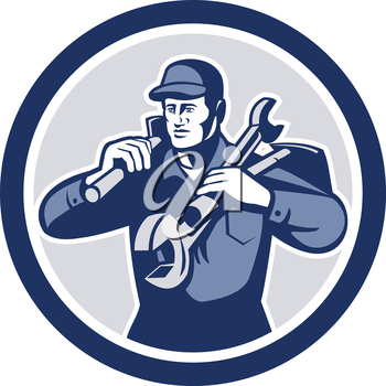 Illustration of a repairman mechanic tradesman handyman worker carrying spanner wrench and spade viewed from front iset inside circle on isolated background done in retro style.