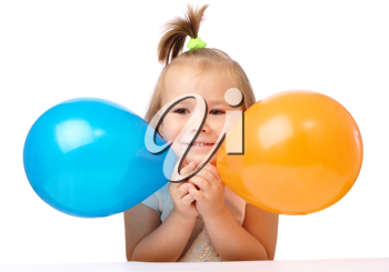 Royalty Free Photo of a Girl With Balloons