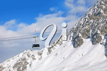 Royalty Free Photo of a Gondola on Cable in Switzerland