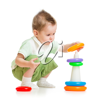 Cute child playing colorful tower isolated on white