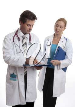 Two doctors discuss a patients medical ailment or treatment.