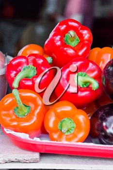 Photo of five fresh red raw pepper