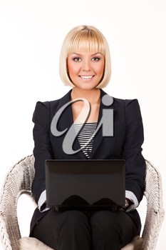 Young blonde woman with computer on a studio isolated background