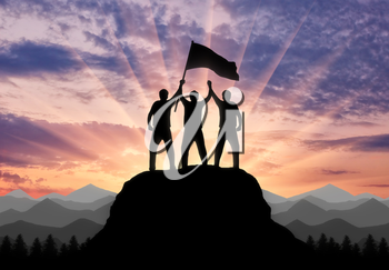 Silhouette of two climbers on a mountain top with a flag in his hand. Concept of a business team